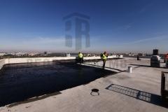 Premazivanje osnovnog premaza (prajmera) kao podlogu za varenje bitumenske trake, na ravnom krovu