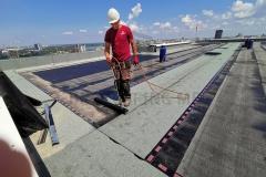 Varenje brenerom završni sloj bitumenske hidroizalicije, na ravnom krovu